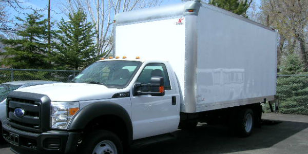 White truck with enclosed bed